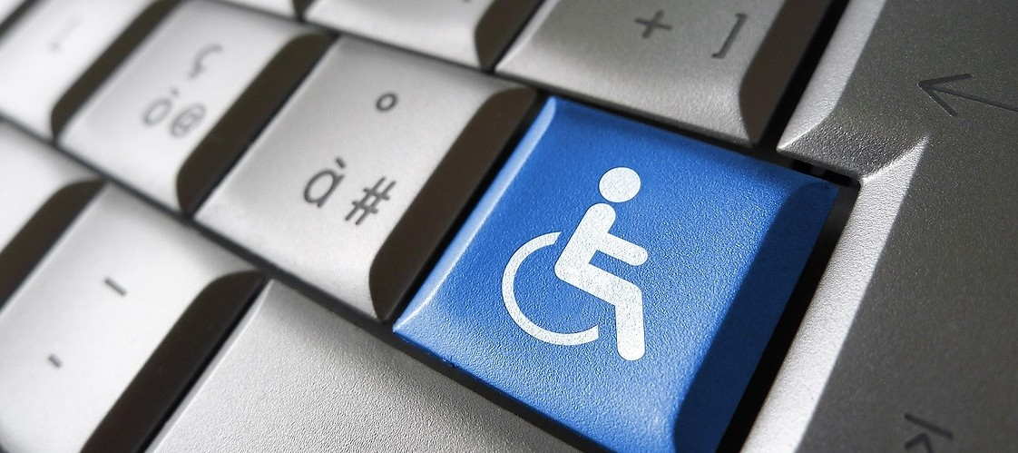 "Keyboard with ""disability"" icon on button"