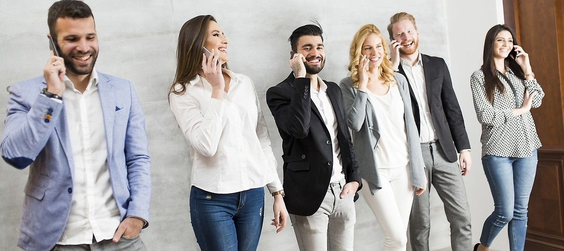 A group of people with mobile phones